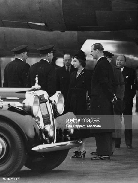 Queen Elizabeth II wearing black pictured with Prince Philip Duke of Edinburgh as she arrives back home from Nairobi Kenya after her Commonwealth...