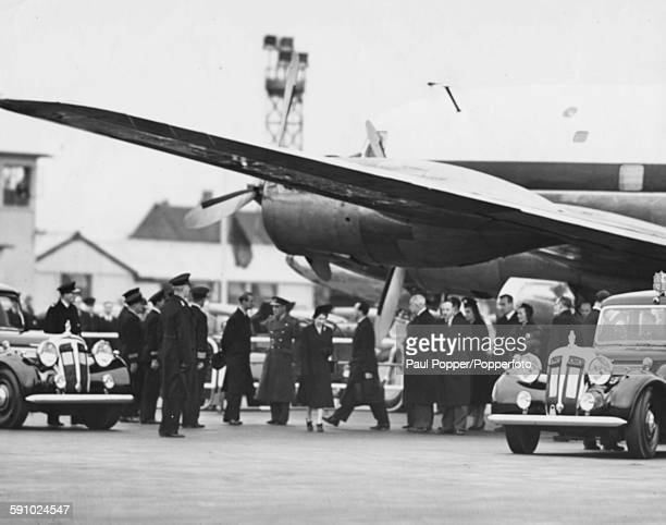Queen Elizabeth II wearing black with Prince Philip Duke of Edinburgh as she arrives back home from Nairobi Kenya following the death of her father...