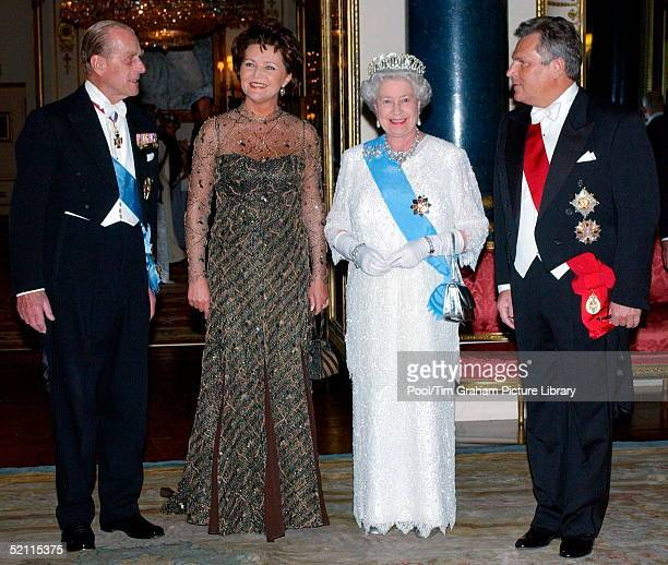 Queen Elizabeth II Wearing Decorations And Orders With Diamonds And Pearls At Buckingham Palace To Host A State Banquet Left To Right Prince Philip...