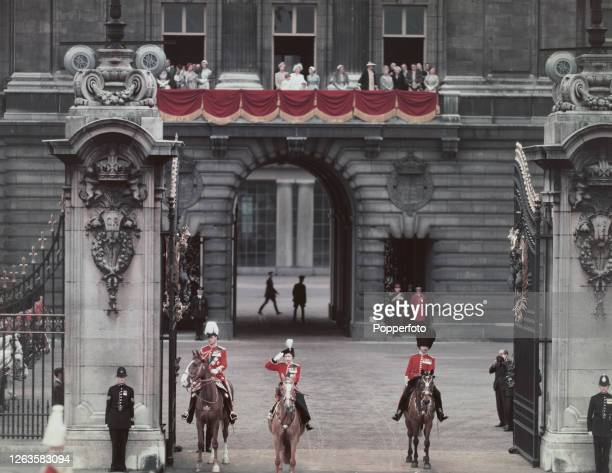 Queen Elizabeth II wearing her red guards uniform and riding her horse Winston accompanied by Prince Philip Duke of Edinburgh takes the salute at...