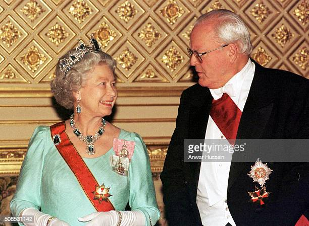 Queen Elizabeth II wearing the Brazalian Aquamarine Parure Tiara and President Herzog of Germany attend a State Banquet in St George's Hall in...