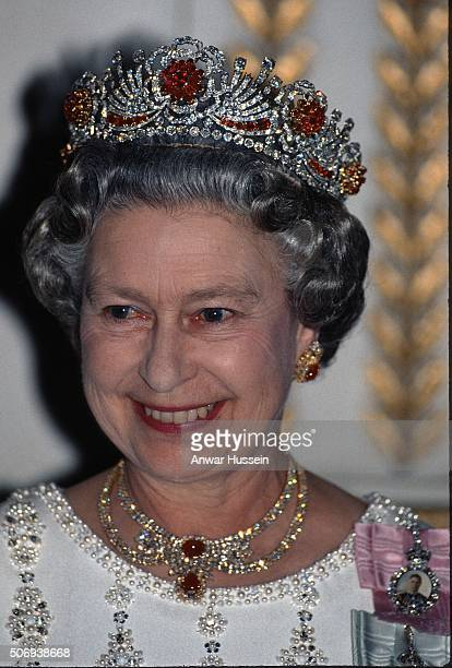 Queen Elizabeth II, wearing the Burmese Ruby Tiara, attends a banquet at the Elysee Palace on June 09, 1992 in Paris, France.