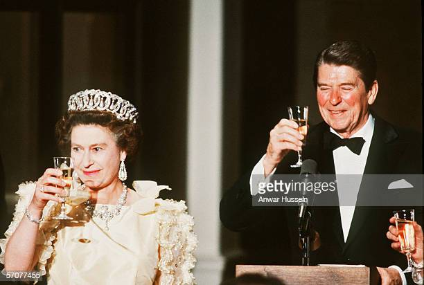 Queen Elizabeth II wearing tiara and diamonds, makes a toast with former US President Ronald Reagan at a banquet in 1983, in San Francisco, USA.