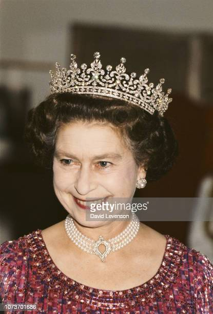 Queen Elizabeth II wears a four strand diamond and pearl choker with 'Granny's Tiara' to a banquet in Bangladesh, 16th November 1983.