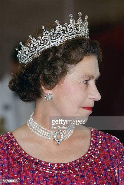Queen Elizabeth II wears a four strand diamond and pearl choker with 'Granny's Tiara' to an engagement in Bangladesh.