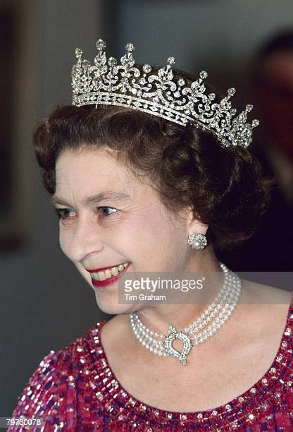 Queen Elizabeth II wears a four strand diamond and pearl choker with 'Granny's Tiara' to an engagement in Bangladesh