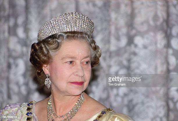 Queen Elizabeth II wears the Russian fringe diamond tiara whilst attending a State Banquet in Reykjavik Iceland