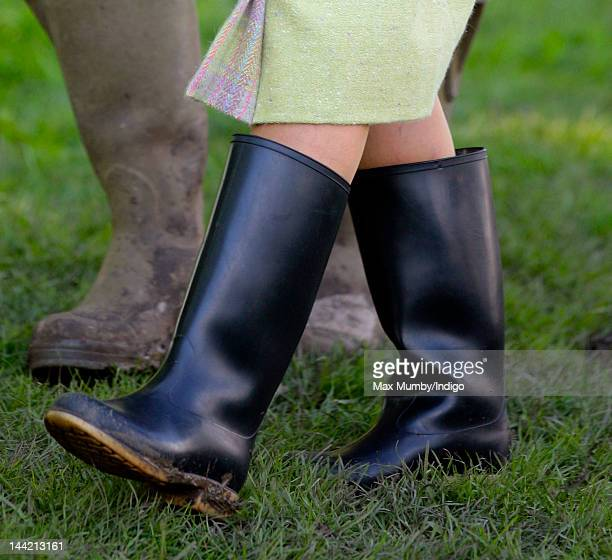 Queen Elizabeth II wears wellington boots as she attends day 3 of The Royal Windsor Horse Show at Home Park on May 11 2012 in Windsor England