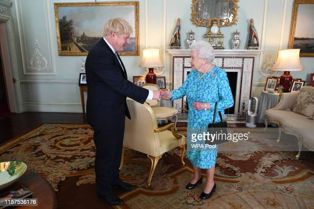 Queen Elizabeth II welcomes newly elected leader of the Conservative party, Boris Johnson during an audience where she invited him to become Prime...