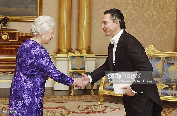 Queen Elizabeth II welcomes the Ambassador of Nicaragua Mr Piero Paolo Coen Ubilla to Buckingham Palace on October 11 2005 in London England