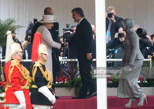 Queen Elizabeth II welcomes The President of Turkey Abdullah Gul and Hayrunnisa Gul on Horse Guards Parade on November 22 2011 in London England The...
