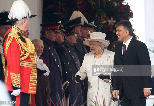 Queen Elizabeth II welcomes The President of Turkey Abdullah Gul on Horse Guards Parade on November 22 2011 in London England The President of Turkey...