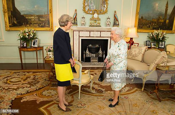 Queen Elizabeth II welcomes Theresa May at the start of an audience where she invited the former Home Secretary to become Prime Minister and form a...