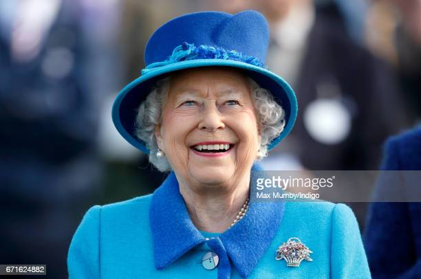 Queen Elizabeth II who celebrated her 91st birthday yesterday watches the racing as she attends the Dubai Duty Free Spring Trials Meeting at Newbury...