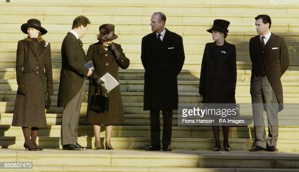 Queen Elizabeth II wipes her eyes as she stands with Sarah Chatto Viscount Linley the Duke of Edinburgh Serena Linley and Daniel Chatto on the steps...
