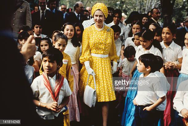 Queen Elizabeth II with a group of local children during her state visit to Mexico FebruaryMarch 1975