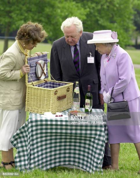 Queen Elizabeth II with actress Prunella Scales and Sir David Ford the Chairman of CPRE at the council picnic in Windsor Great Park London to...