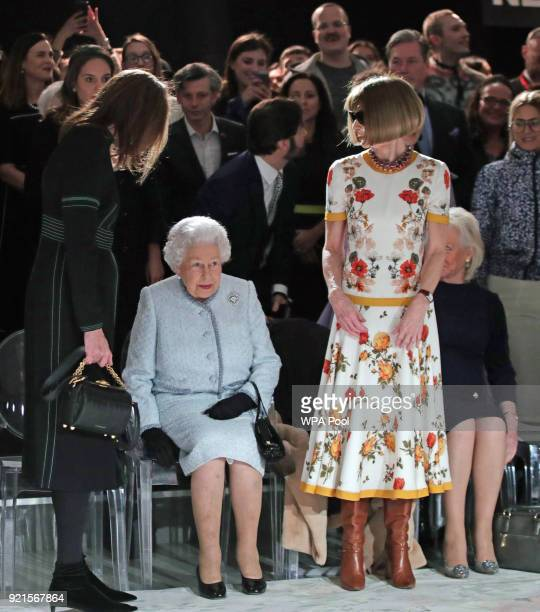 Queen Elizabeth II with Anna Wintour and Caroline Rush chief executive of the British Fashion Council before presenting to Richard Quinn the...
