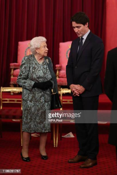 Queen Elizabeth II with Canadian Prime Minister Justin Trudeau at a reception for NATO leaders hosted by Queen Elizabeth II at Buckingham Palace on...