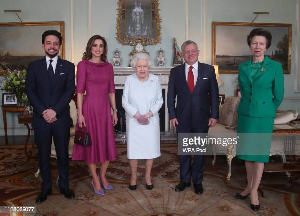 Queen Elizabeth II with Crown Prince Hussein of Jordan Queen Rania of Jordan King Abdullah II of Jordan and Princess Anne Princess Royal during a...