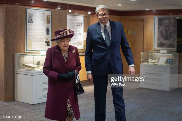 Queen Elizabeth II with Director General Andrew Parker during a visit to the headquarters of MI5 at Thames House on February 25 2020 in London...