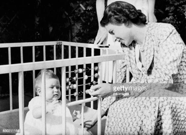 Queen Elizabeth II with her baby Prince Charles in the grounds of Windlesham Moor country home in Surrey