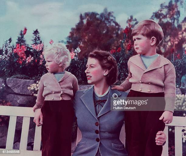 Queen Elizabeth II with her children Charles and Anne at Balmoral 1952