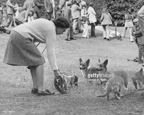 Queen Elizabeth II with her corgis at Virginia Water in Surrey for the European Driving Championships 12th May 1973 The Duke of Edinburgh is taking...