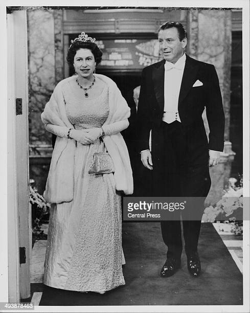 Queen Elizabeth II, with her escort Lord Bernard Delfont, attending the Royal Variety Performance at the London Palladium, November 9th 1965.