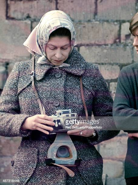 Queen Elizabeth II with her Leica camera during the Badminton Horse Trials in Gloucestershire circa April 1973