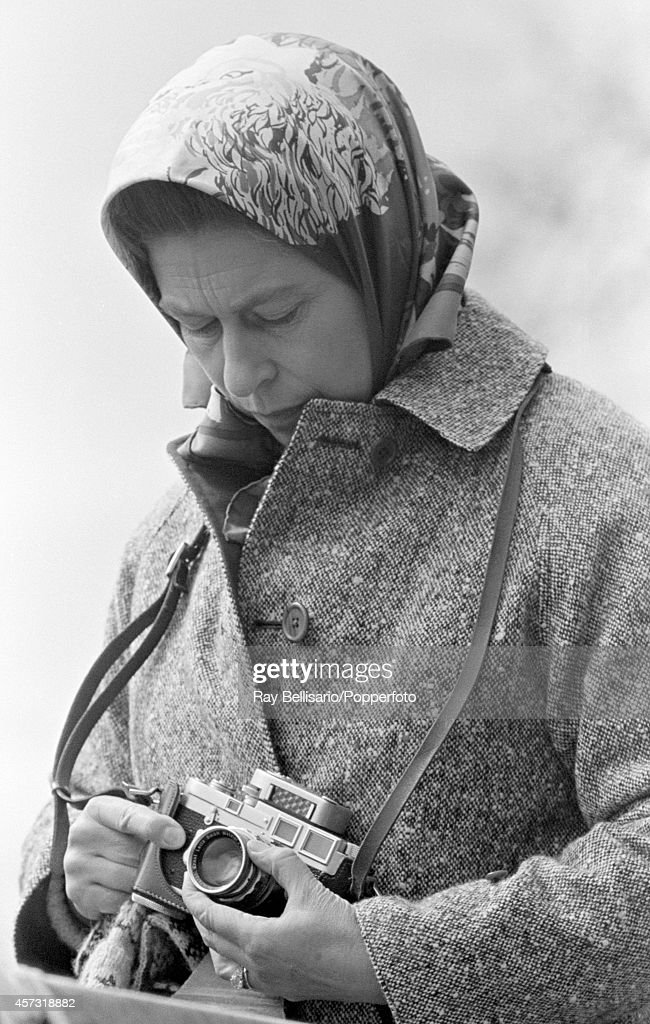 Queen Elizabeth II with her Leica camera during the Badminton Horse Trials in Gloucestershire on 15th April 1972.
