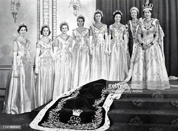 Queen Elizabeth II with her Mistress of the Robes and the six Maids of Honour after her coronation. 1953.