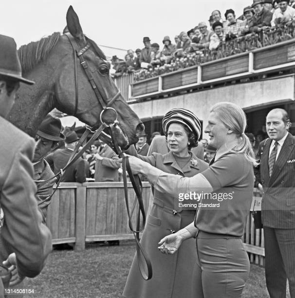 Queen Elizabeth II with her racehorse Highclere, after the horse won the 1000 Guineas Stakes at Newmarket, UK, 2nd May 1974.