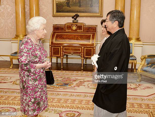 Queen Elizabeth II with His Excellency Mr Koji Tsuruoka the Ambassador of Japan who was accompanied by his wife Mrs Tsuruoka during a private...
