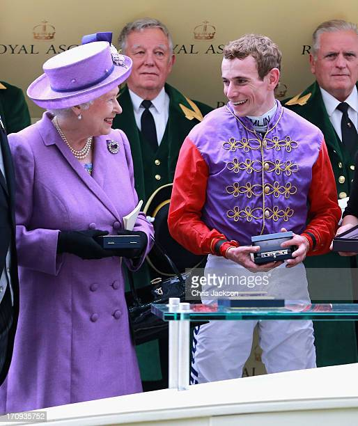 Queen Elizabeth II with jockey Ryan Moore as they celebrate winning The Gold Cup during Ladies' Day on day three of Royal Ascot at Ascot Racecourse...