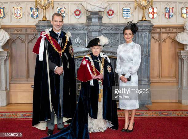 Queen Elizabeth II with King Felipe VI of Spain and Queen Letizia of Spain , after the king was invested as a Supernumerary Knight of the Garter,...