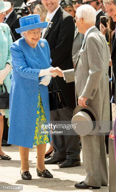 Queen Elizabeth II with Lester Piggott at the unveiling of a statue of the jockey at the Epsom Derby at Epsom Racecourse on June 1 2019 in Epsom...