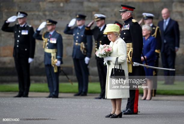 Queen Elizabeth II with Major General Mike RiddellWebster Governor of Edinburgh Castle before inspecting members of the Balaklava Company during the...