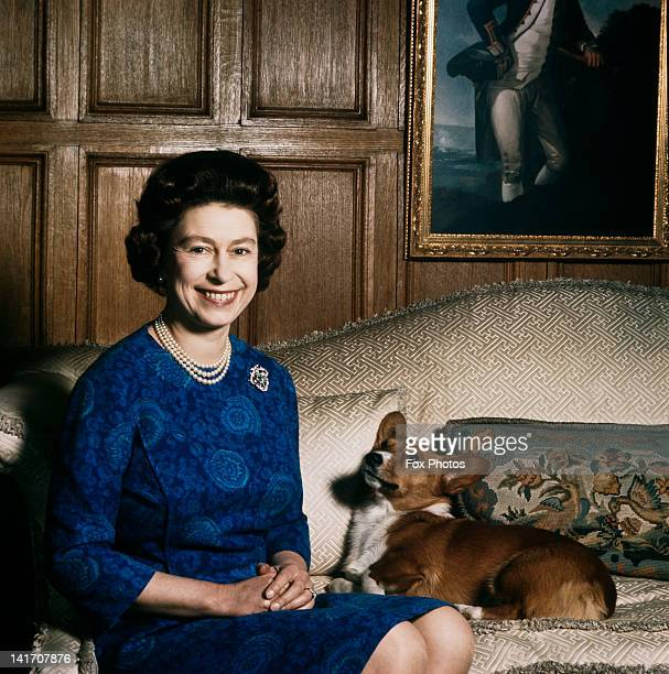 Queen Elizabeth II with one of her corgis at Sandringham 1970