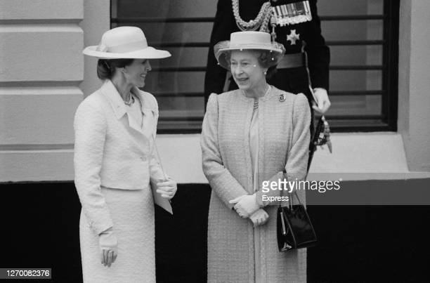 Queen Elizabeth II with Paloma de la Madrid the wife of Mexican President Miguel de la Madrid at Victoria Station during the couple's state visit to...