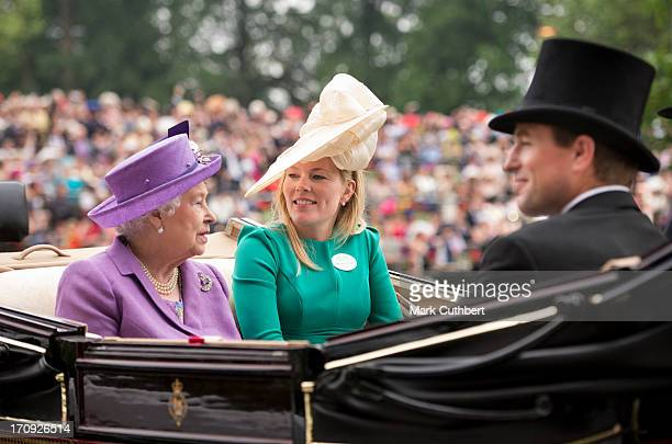 Queen Elizabeth II with Peter Phillips and Autumn Phillips attend Ladies Day on Day 3 of Royal Ascot at Ascot Racecourse on June 20 2013 in Ascot...