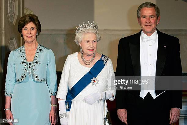 Queen Elizabeth II with President George W Bush and his wife Laura Bush attend a State Dinner at the White House on the fifth day of her USA tour on...