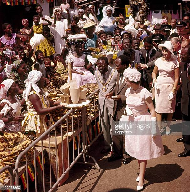 Queen Elizabeth II with President Kwame Nkrumah of Ghana greeting crowds in the marketplace of Accra during the Royal Tour of West Africa circa...