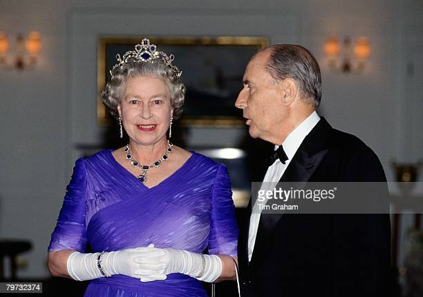 Queen Elizabeth II with President Mitterrand at a banquet on board the Royal Yacht Britannia during her visit to France The Queen is wearing the King...