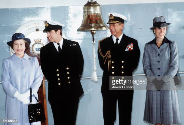 Queen Elizabeth II with Prince Andrew, the Duke of York, Prince Philip, the Duke of Edinburgh and Princess Anne, the Princess Royal on board HMS...