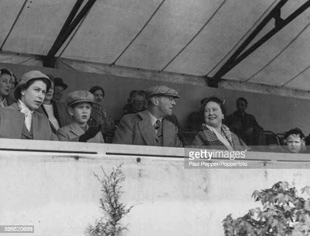 Queen Elizabeth II with Prince Charles Henry Somerset 10th Duke of Beaufort Queen Elizabeth the Queen Mother and Princess Anne pictured together in...