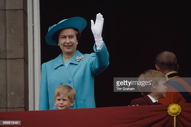 Queen Elizabeth II with Prince Harry and Prince William on the balcony at Buckingham Palace for Trooping The Colour 11th July 1988