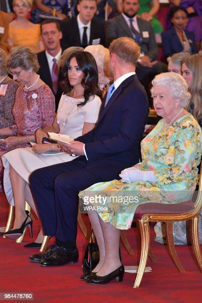 Queen Elizabeth II with Prince Harry Duke of Sussex and Meghan Duchess of Sussex at the Queen's Young Leaders Awards Ceremony at Buckingham Palace on...