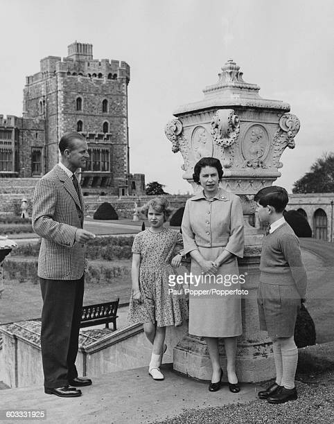 Queen Elizabeth II with Prince Philip Duke of Edinburgh and their children Princess Anne and Prince Charles on the top of the East Terrace Garden...