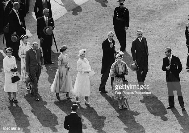 Queen Elizabeth II with Prince Philip Duke of Edinburgh the Queen Mother Princess Margaret and the Duke and Duchess of Gloucester walk back to...
